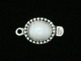 PEARL OVAL WITH DOT PATTERN